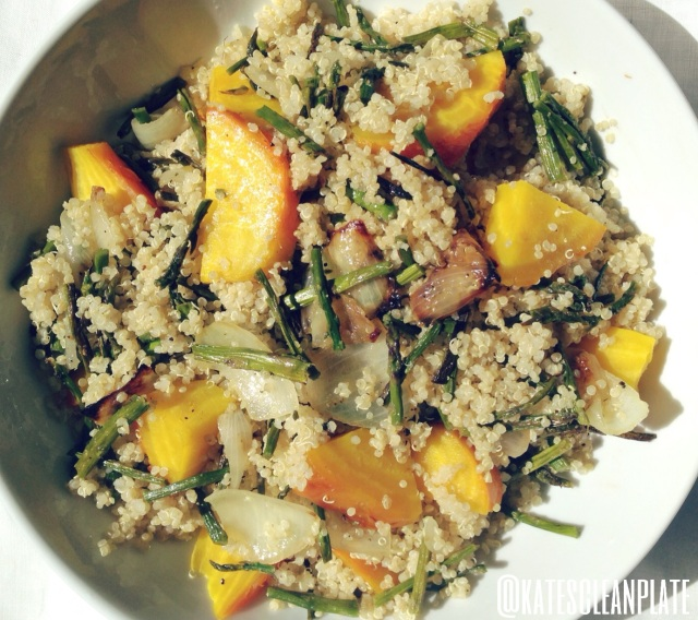 Warm quinoa salad with roasted asparagus, onion and golden beets