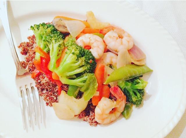 Shrimp stir fry over redquinoa
