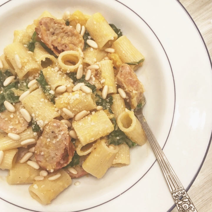 Butternut squash sauce over pasta, with sausage, spinach and pinenuts!