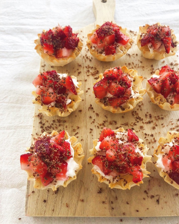 Strawberries and cream phyllo cups with shaved milk chocolate!